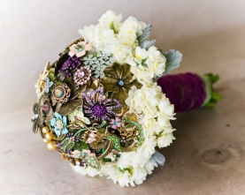 brooch bouquet with purple velvet ribbon handle via fancypantsweddings.com