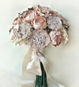 dusty pink brooch bouquet via banffandcanmoreweddingplanner.com